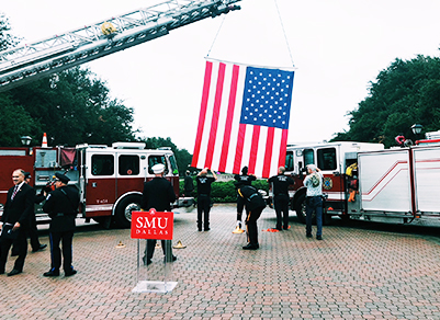 American flag hanging by the ladder of a fire truck