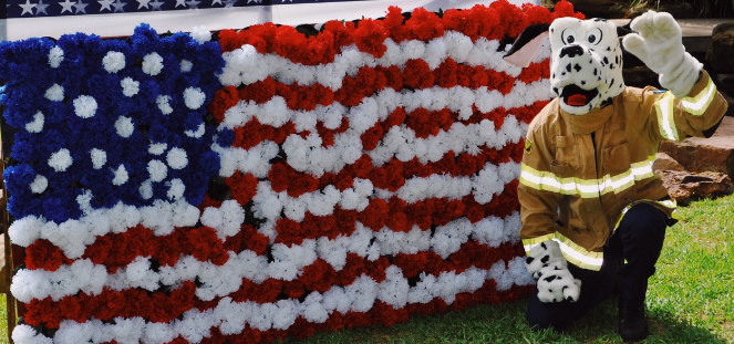 Sparky the Fire Dog with U.S. flag